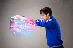 Casual man holding laptop with exploding data and numbers Stock Images