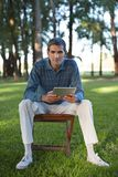 Casual Man Holding Tablet PC Stock Images