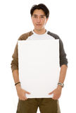Casual man holding a white board Stock Images