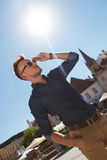 Casual man holds sunglasses Royalty Free Stock Photography