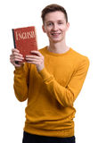 Casual man holds a textbook. learning english. Casual young man holds a textbook. learning english. Isolated on white Royalty Free Stock Photos