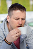 Casual man, hot cup of coffee. Coffee lover concept. Royalty Free Stock Images