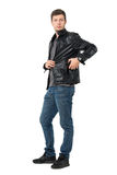 Casual man in jeans and leather jacket put mobile phone inside pocket Stock Images