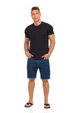 Casual Man In Jeans Shorts And Black T-Shirt Stock Photo