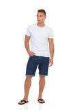 Casual Man In Jeans Shorts And White T-Shirt Royalty Free Stock Images