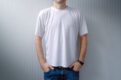 Casual man in jeans trousers and white t-shirt Stock Photo