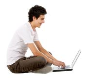 Casual man on a laptop Royalty Free Stock Photo