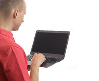Casual man with laptop Stock Photography