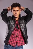 Casual man in leather jacket in a fashion pose Stock Images