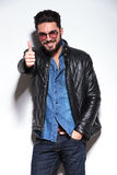 Casual man in leather jacket making the ok sign Royalty Free Stock Image