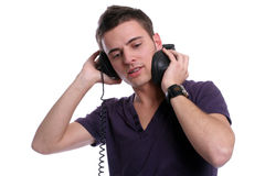 Casual man listening to music. Isolated in white background royalty free stock photo