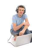 Casual man listening to music in headphones Royalty Free Stock Images