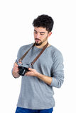 Casual man looking at his camera Stock Image