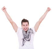 Casual man looking very happy with his arms up royalty free stock image