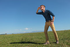 Casual man looks far away Stock Photos