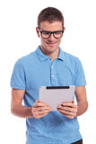 Casual man looks at his tablet Stock Image