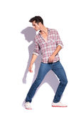 Man stepping & looking in different ways Royalty Free Stock Photography