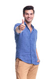 Casual man making the ok thumbs up hand sign Stock Photo