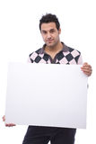 Casual man with message board. Casual young man with a blank message board on white Royalty Free Stock Photos