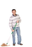 Casual Man Mopping the Floor Royalty Free Stock Image