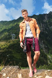 Casual man in the mountains with hand in pocket Stock Photos