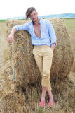 Casual man outdoor with hand in pocket and on haystack Stock Photo