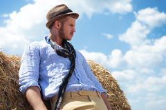 Casual man outdoor looks away frowned Stock Image
