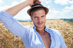 Casual man outdoor with straw behind ear Stock Images