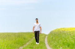 Casual man walking outdoors Royalty Free Stock Image