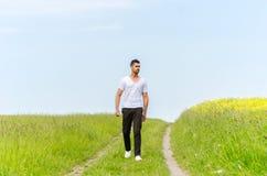 Casual man walking outdoors Stock Photos