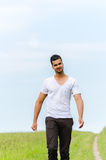 Casual man walking outdoors Royalty Free Stock Photo