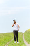 Casual man walking outdoors Royalty Free Stock Photography