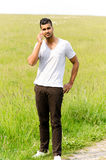 Casual man talking in phone outdoors Stock Photo