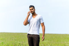 Casual man talking in phone outdoors Royalty Free Stock Photography