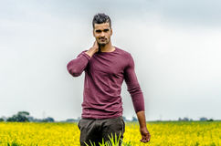 Casual man outdoors on a field Royalty Free Stock Images