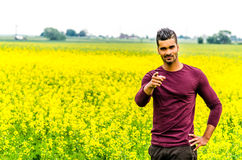 Casual man outdoors on a field Royalty Free Stock Photography