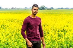 Casual man outdoors on a field Stock Images