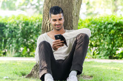 Casual man using phone outdoors Royalty Free Stock Images