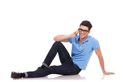 Casual man on the phone from the floor Royalty Free Stock Image