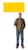 Casual man with a placard Royalty Free Stock Image