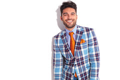 Casual man in plaid jacket and orange tie Royalty Free Stock Photos