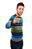 Casual man pointing in front. Smiling casual man pointing in front. White background Stock Photography