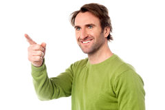 Casual man pointing at something Stock Images