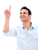 Casual man pointing up Royalty Free Stock Photos