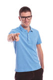 Casual man points at you with hand in pocket Royalty Free Stock Photo