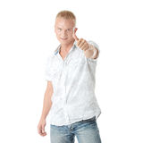 Casual man portrait doing the thumbs up sign Stock Images