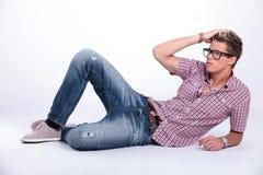 Casual man poses on floor Stock Photos