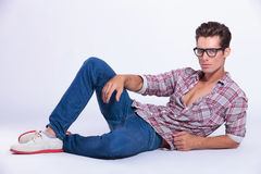 Casual man poses on the floor Stock Photo