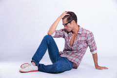 Casual man posing on the floor Stock Images