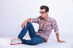 Casual man posing on the ground Stock Photo